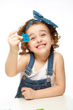 Little girl playing in the alphabet. Shows the letter B. Royalty Free Stock Photo