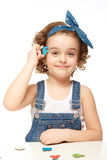 Little girl playing in the alphabet. Shows the letter F. Stock Photography