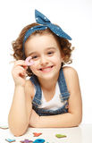 Little girl playing in the alphabet. Shows the letter G. Stock Photos