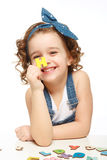 Little girl playing in the alphabet. Shows the letter H. Royalty Free Stock Images