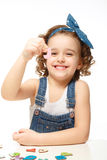Little girl playing in the alphabet. Shows the letter J. Stock Images