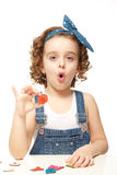 Little girl playing in the alphabet. Shows the letter O. Stock Photography