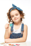 Little girl playing in the alphabet. Shows the letter R. Stock Image