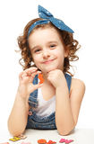 Little girl playing in the alphabet. Shows the letter S. Royalty Free Stock Photography