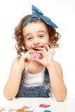 Little girl playing in the alphabet. Shows the letter W. Stock Image