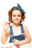 Little girl playing in the alphabet. Shows the letter Y. Royalty Free Stock Photos