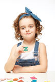 Little girl playing in the alphabet. Shows the letter Z. Royalty Free Stock Photography