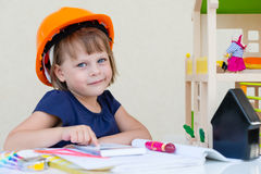 Little girl playing architect Royalty Free Stock Images