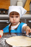Little girl is playing as a cook Stock Photo