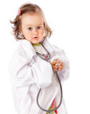 A little girl is playing as a doctor Royalty Free Stock Photography
