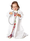 A little girl is playing as a doctor Stock Images