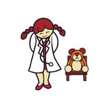 Little girl playing as a doctor with bear Stock Photography