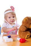 Little girl playing as doctor with stethoscope Stock Photo