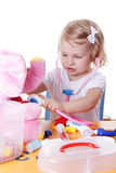 Little girl playing as doctor with stethoscope Royalty Free Stock Photo