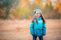 Little girl playing on autumn Stock Images