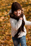Little girl playing in autumn park Stock Photography
