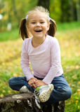 Little girl is playing in autumn park Stock Photography