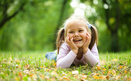 Little girl is playing in autumn park Royalty Free Stock Photography