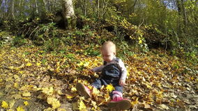Little girl playing in the autumn park. Full HD stock video