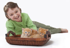 A little girl playing with baby cat. A beautiful little girl playing with two cute baby cats Royalty Free Stock Photography