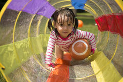 Little girl playing in backyard. royalty free stock photo