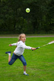 Little girl playing badminton outdoors Royalty Free Stock Photography