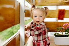 Little girl playing on the balcony Royalty Free Stock Photography