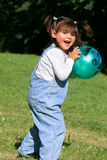 Little Girl Playing Ball Royalty Free Stock Photos