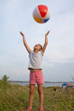 Little girl playing with a ball outdoors Royalty Free Stock Image
