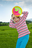 Little girl playing with a ball in the par Royalty Free Stock Photo