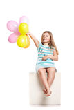 Little girl playing with balloons Stock Photo