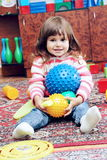 Little Girl Playing with Balls Royalty Free Stock Images