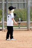 Little girl playing baseball fielder royalty free stock images