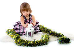 Little girl playing with baubles Stock Image