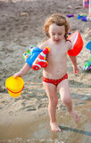 Little girl playing at the beach Royalty Free Stock Photo