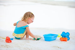 Little girl playing at beach Royalty Free Stock Photos