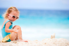 Little girl playing at beach Royalty Free Stock Photography