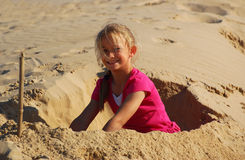 Little girl playing on beach Royalty Free Stock Photos