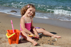 Little girl playing on beach Royalty Free Stock Photography