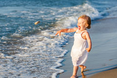 Little girl playing on the beach Royalty Free Stock Photography