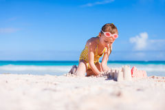 Little girl playing at beach Royalty Free Stock Photo