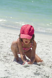 A little girl playing on the beach Stock Photo
