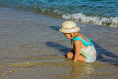 Little Girl Playing On The Beach. At the Aegean Sea Stock Photography