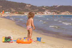 Little Girl Playing On The Beach Royalty Free Stock Photo