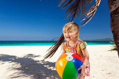 Little girl playing on beach with ball Royalty Free Stock Photo