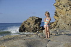 A little girl is playing on the beach. Royalty Free Stock Photography