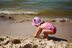 Little girl playing on the beach Royalty Free Stock Image
