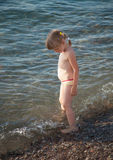 Little girl playing on a beach Royalty Free Stock Images