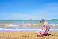 Little girl playing on the beach Royalty Free Stock Images