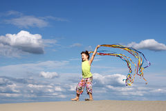 Little girl playing on beach summer scene Royalty Free Stock Images